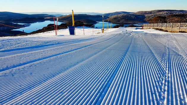 The grooves are created by snow grooming machines and are known colloquially as