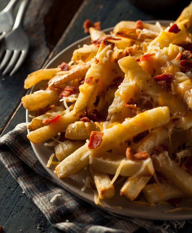 Homemade salty cheese French fries with
