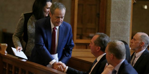 Opposition Leader Bill Shorten greets Deputy Prime Minister Barnaby Joyce at a church service to mark...