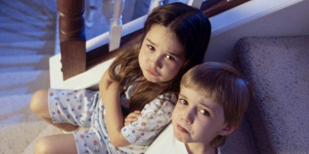 High angle view of a brother and sister sitting on