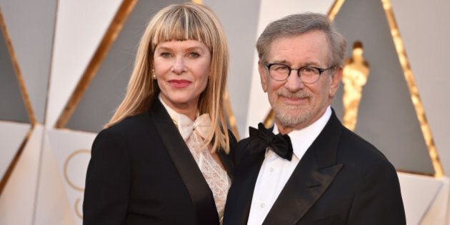 Kate Capshaw, left, and Steven Spielberg arrive at the Oscars on Sunday, Feb. 28, 2016, at the Dolby...