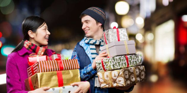 Couple with packages,shopping in city.