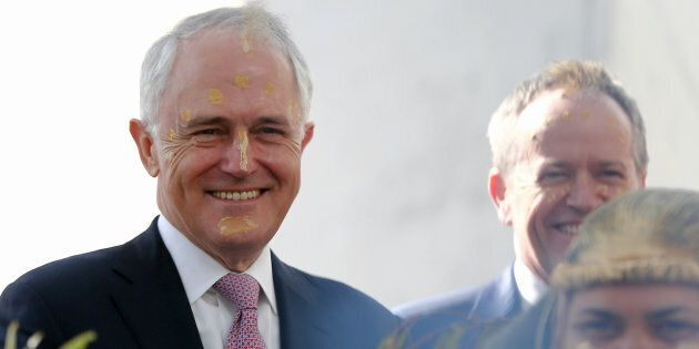 Malcolm Turnbull and Bill Shorten during the smoking ceremony at the welcome to country