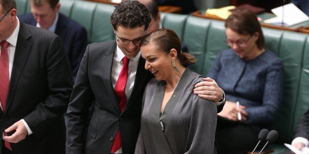 Tim Watts comforts Anne Aly after she was sworn in as the member for