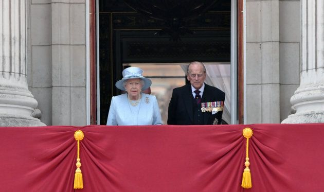 Queen Elizabeth ll and Prince Philip, Duke of Edinburgh look out from the balcony of Buckingham Palace during the annual Trooping the Colour parade on June 17, 2017 in London, England.