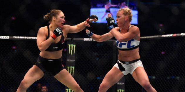 MELBOURNE, AUSTRALIA - NOVEMBER 15: (L-R) Ronda Rousey faces Holly Holm in their UFC women's bantamweight...