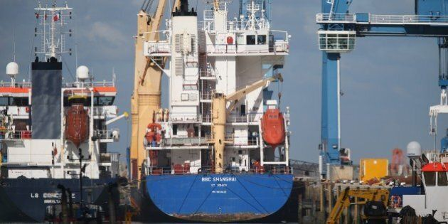 A picture taken on October 14, 2015 in Cherbourg-Octeville shows the BBC Shanghai, a vessel whose security...