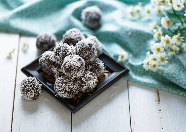 Process some medjool dates with nuts and cacao, and roll in coconut for quick, easy energy