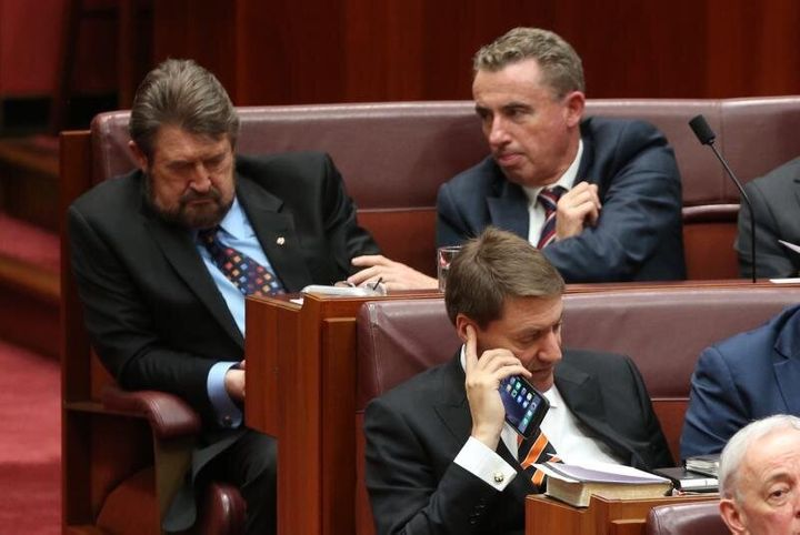 Wake Up! Senator Derryn Hinch is nudged by Kevin Hogan during the opening of the 45th Parliament