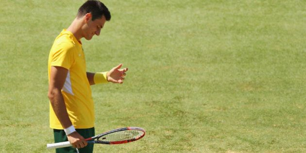 MELBOURNE, AUSTRALIA - MARCH 06: Bernard Tomic of Australia loses a point in his match against John Isner...