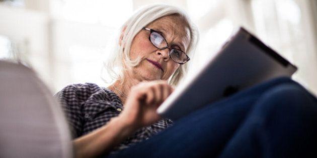 senior woman using tablet