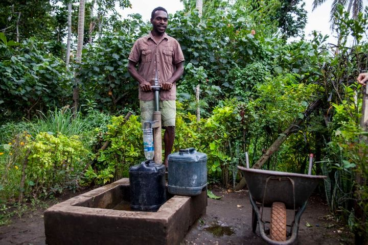 A Taloa man fetches washing water for his family. The community currently has to use hand pumps from a deep bore. They hope that one day they will have a solar powered pump system.