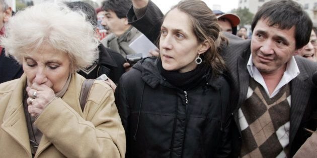 Estela de Carlotto, president of the Grandmothers of the Plaza de Mayo with a brother and sister of the disappeared.