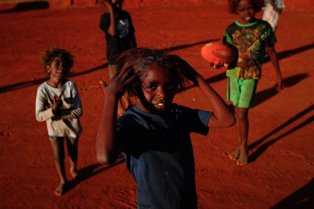 Children playing footy during the closing ceremony in the Mutitjulu community of the First Nations National Convention held in Uluru in May