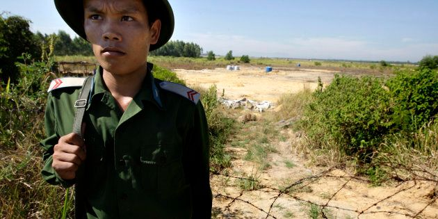 A Vietnamese soldier guards the contaminated site at the edge of the Da Nang Airfield on July 1, 2009 in Da Nang, Central Vietnam. During the Vietnam War, the U.S. military stored more than four million of gallons of herbicides, including Agent Orange, at the military base that is now a domestic and military airbase.