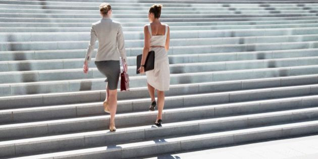 Businesswomen walking up steps