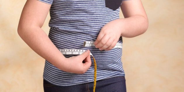 Obese child measuring