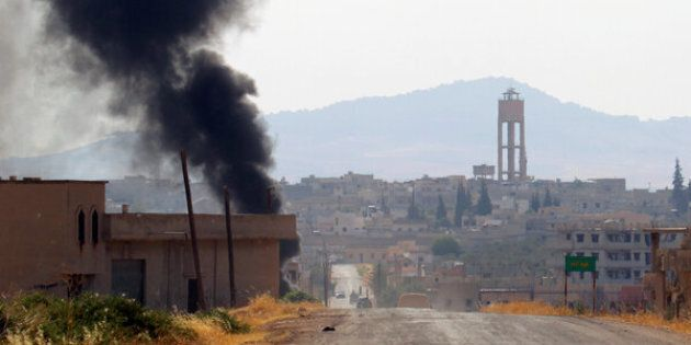 Smoke rises from Taybat al Imam town after rebel fighters from the hardline jihadist Jund al-Aqsa advanced in the town in Hama province, Syria August 31, 2016. REUTERS/Ammar Abdullah