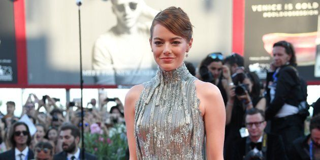 US actress Emma Stone poses on the red carpet as she arrives for the screening of the movie 'La La Land' at the opening ceremony of the 73rd Venice Film Festival, on August 31, 2016 at Venice Lido. / AFP / TIZIANA FABI        (Photo credit should read TIZIANA FABI/AFP/Getty Images)