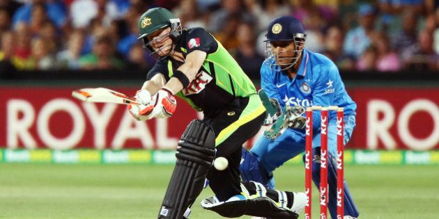 ADELAIDE, AUSTRALIA - JANUARY 26: Steve Smith of Australia bats in front of MS Dhoni of India during...