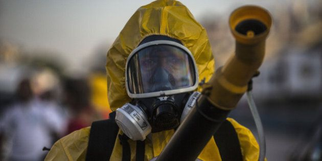 A worker fumigates the Sambadrome ahead of Carnival celebrations in Rio de Janiero, Brazil, on Tuesday, Jan. 26, 2016. The operation is part of the Health Ministry's efforts to eradicate the Aedes aegypti mosquito, which is thought to spread the Zika virus being blamed for causing birth defects. Photographer: Dado Galdieri/Bloomberg via Getty Images
