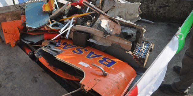 Parts of the wrecked Dauphin AS365 rescue helicopter, which crashed into cliffs just minutes from reaching...