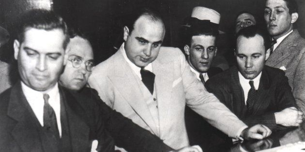 Al Capone signing Uncle Sam's Bail Bond, June 7, 1931, United States. (Photo by: Photo12/UIG via Getty Images)