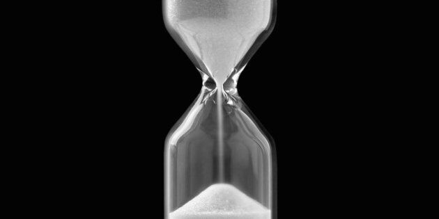 Egg timer against black background, close-up