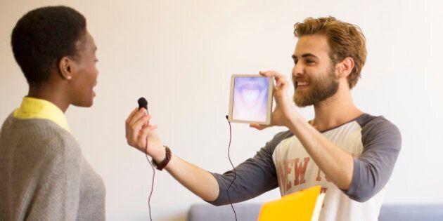 Creative businessman holding digital tablet and headphone