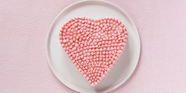 Pink heart shaped cake decorated whipped cream,aerial