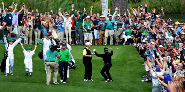 Gary Player, right, and the gallery react to his hole-in-one from the seventh tee box during the Par...