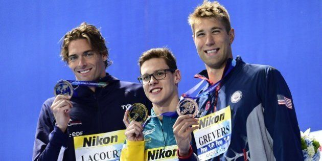 Australia's Mitchell Larkin (C), gold, France's Camille Lacourt (L), silver, and USA's Matt Grevers pose...