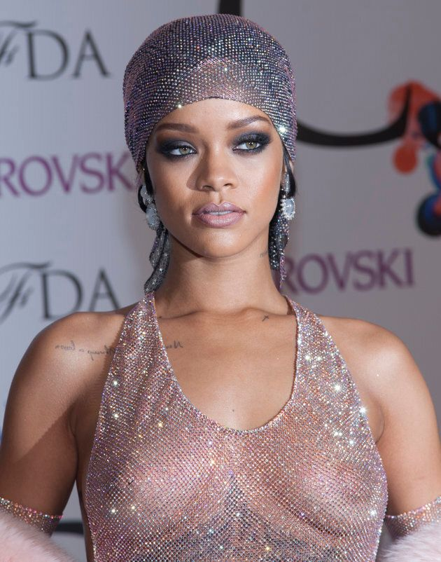Rihanna on the red carpet for the 2014 CFDA Fashion Awards.