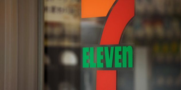 The 7-Eleven logo is displayed at a convenience store, operated by Seven & i Holdings Co., in Kawasaki...