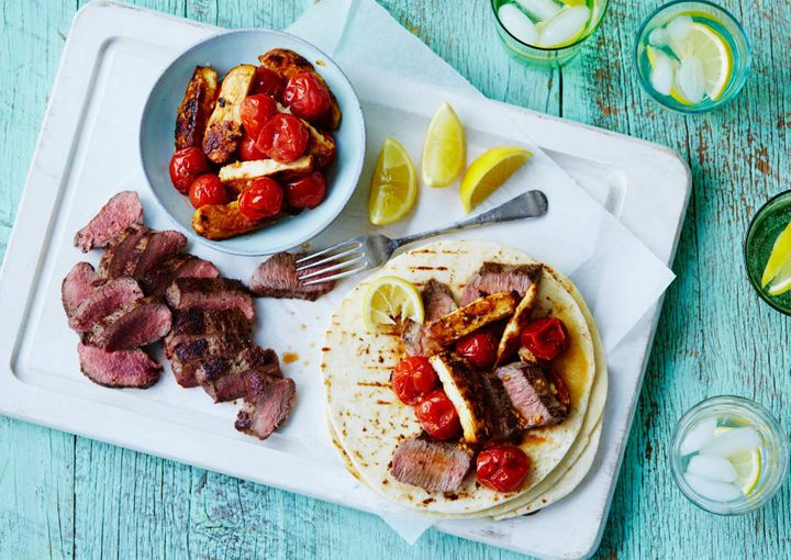 Portion the lamb, halloumi and cherry tomatoes into plastic containers, and heat up and serve with the wraps at work.