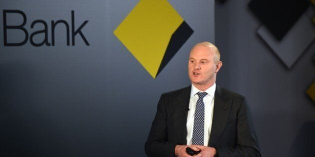 Ian Narev, managing director and chief executive officer of the Commonwealth Bank Group, speaks at a press conference following the bank's annual results in Sydney on August 12, 2015. The Commonwealth Bank, the nation's largest company by market capitalisation reported August 12 a five percent rise in full-year net profit to a record 9.063 billion AUD (6.62 billion USD), although results slowed in the second-half. AFP PHOTO / Peter PARKS        (Photo credit should read PETER PARKS/AFP/Getty Images)