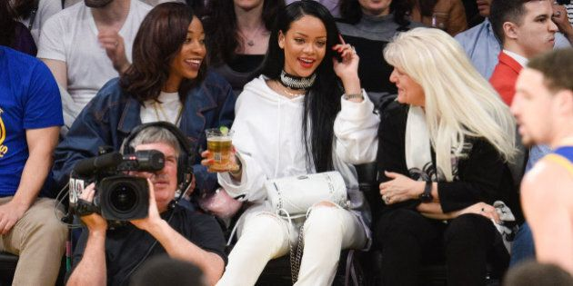 LOS ANGELES, CA - MARCH 06: Rihanna attends a basketball game between the Golden State Warriors and the...