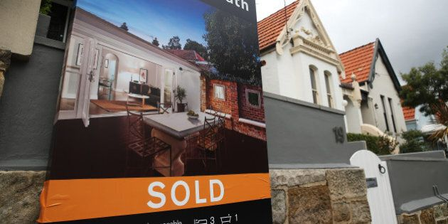 A 'Sold' sign is displayed outside a house in the suburb of Bellevue Hill in Sydney, Australia, on Thursday, June 18, 2015. Surging home prices in cities including Sydney are unlikely to be affected by the banking regulator's efforts to curb mortgage lending to investors, according to National Australia Bank Ltd. Photographer: Brendon Thorne/Bloomberg via Getty Images