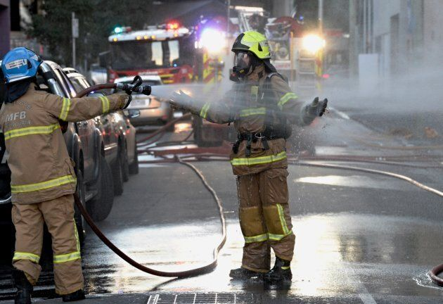Firefighters being hosed during the factory fire. It reportedly took 25 firefighters 40 minutes to bring...