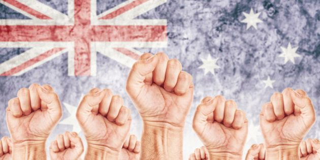 Australia Labor movement, workers union strike concept with male fists raised in the air fighting for...