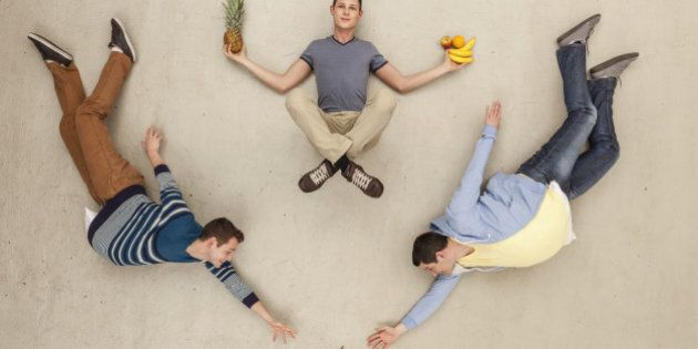 Men with food lying on floor