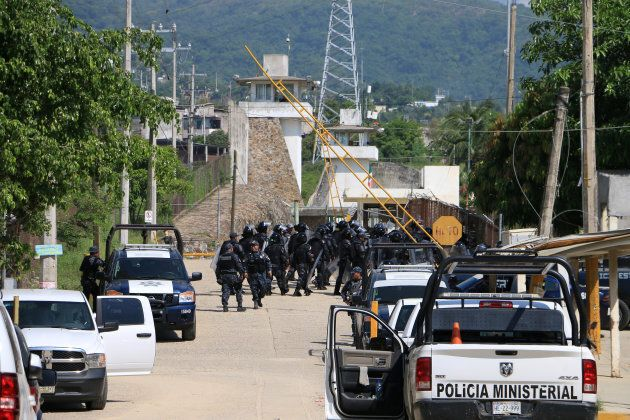 Riot police stormed the Las Cruces prison after the fighting broke out in the early hours of Thursday morning.