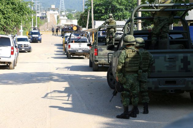 Soldiers and federal police officers set up a security cordon around the prison in the wake of the deadly fighting.