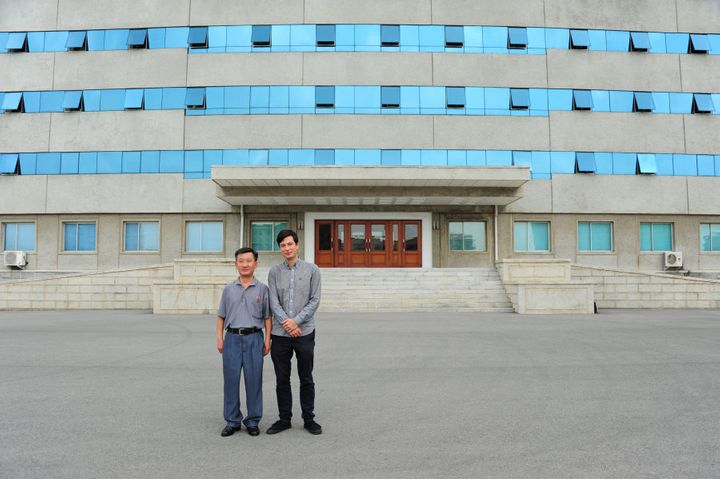 Alek and Mr Ri outside the building they took classes in.