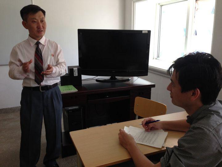 Alek in class with Mr Ri.