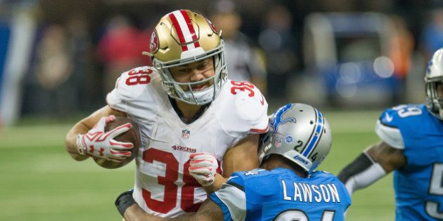DETROIT, MI - DECEMBER 27: Jarryd Hayne #38 of the San Francisco 49ers tries to break a tackle from Nevin...