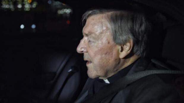 Cardinal George Pell leaving the airport escorted by