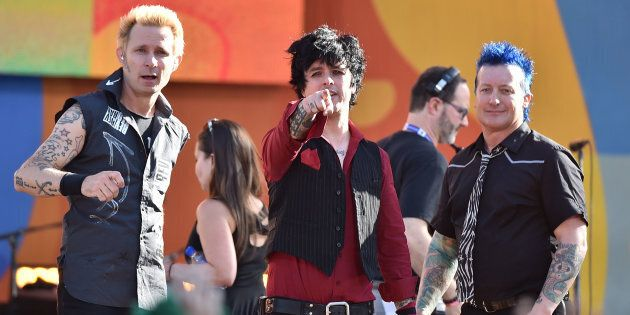 Green Day's Billie Joe Armstrong (centre) has defended the band after they were criticised for performing...