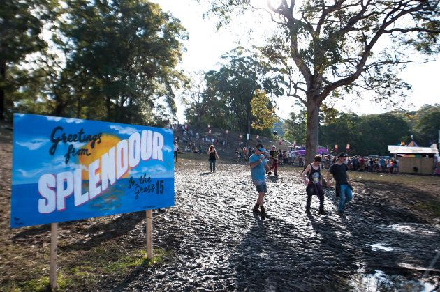 Festival goers make their way through the mud during Splendour in the Grass