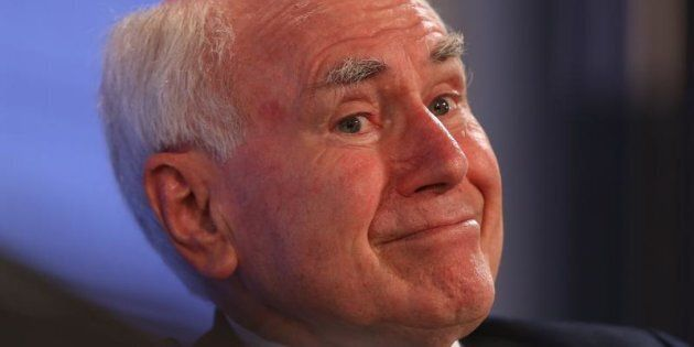 Former Prime Minister John Howard says the goal of equal female representation is probably too